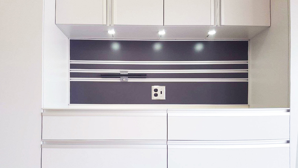 garage-white-lighting-cabinetry