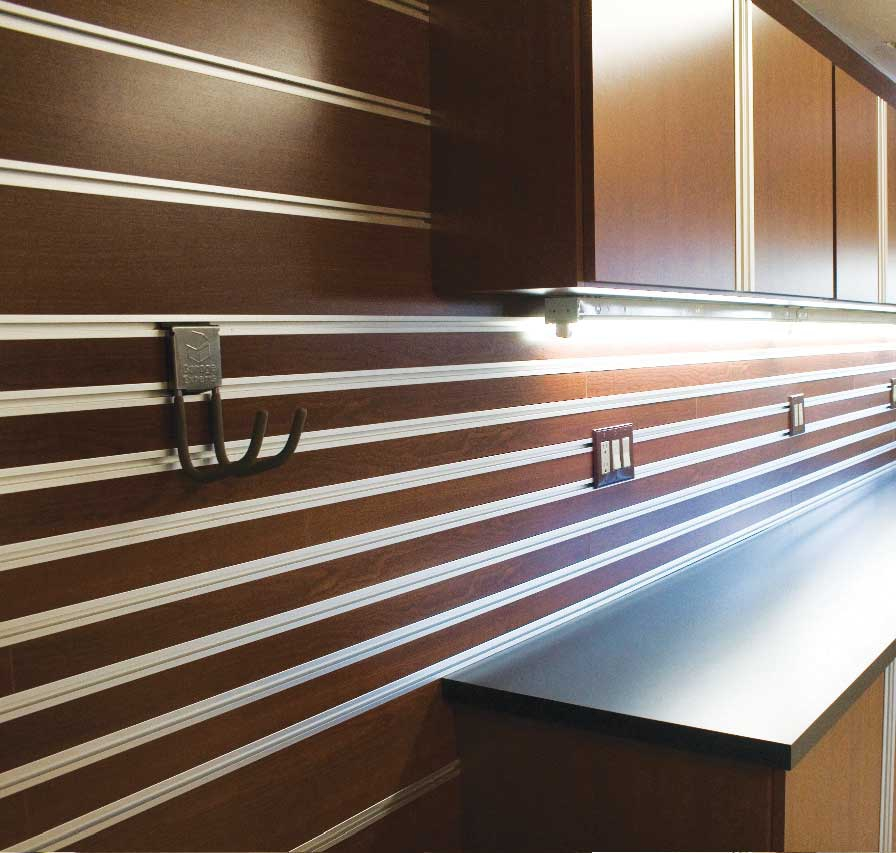 garage-brown-cabinets-lighting-countertop
